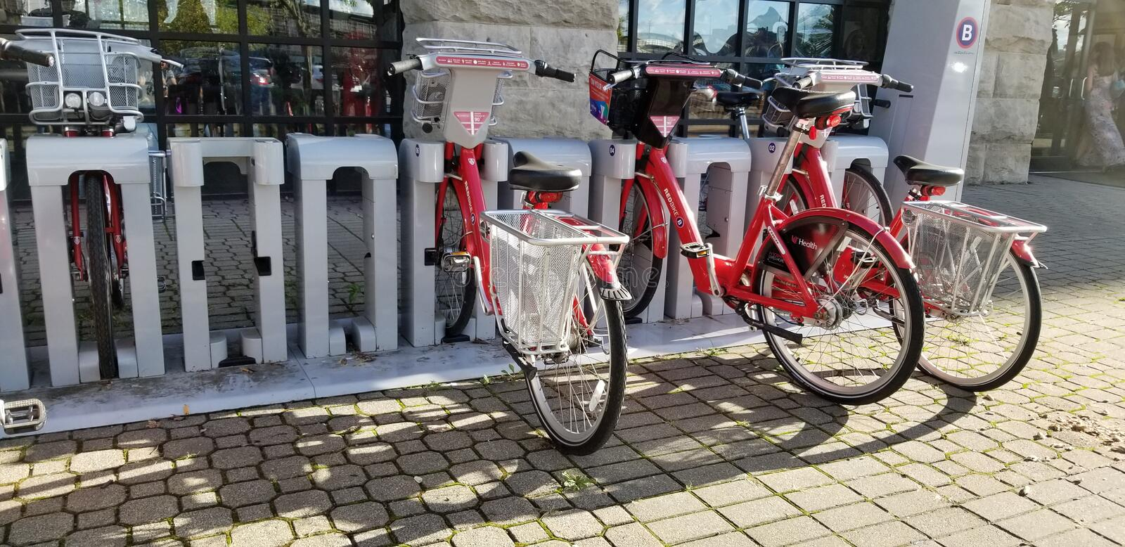 Red Bikes. By Longworth Hall and shadows stock images