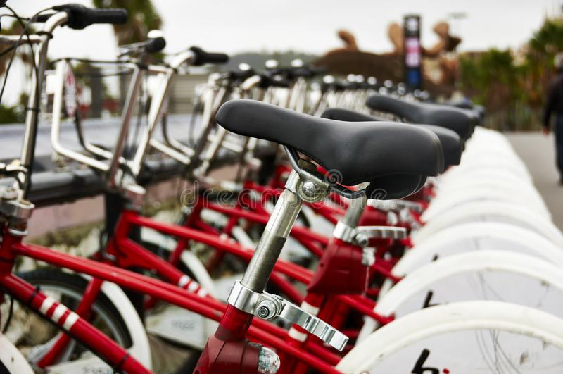 Rent bikes parking in Barcelona. Red bikes parking for rent in Barcelona, Spain stock photography