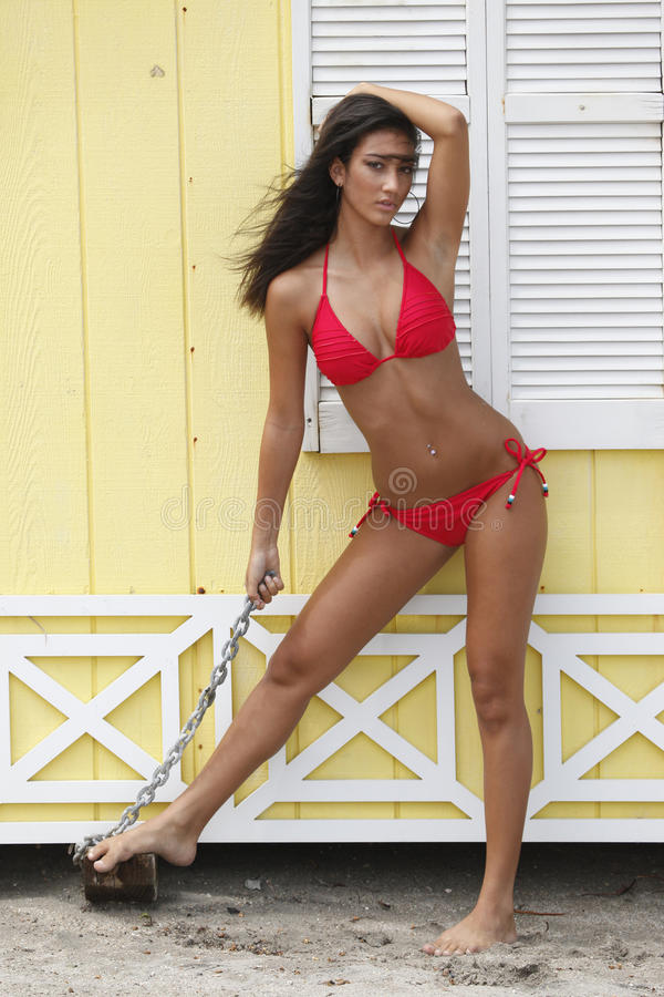 Download Red Bikini On A Yellow Frame Shed Stock Images - Image: 10581934