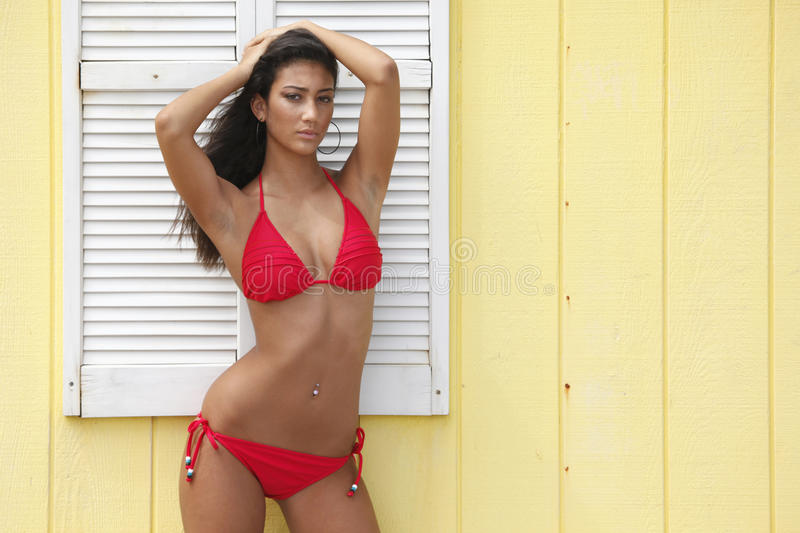 Download Red Bikini On A Yellow Frame Shed Stock Photo - Image: 10581998