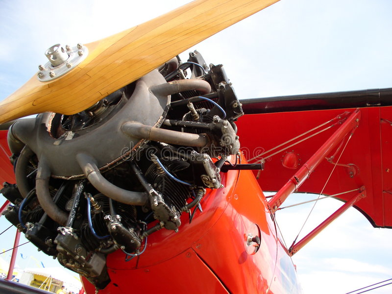 Red Biplane. With open engine waits to start. Barnstormers and air shows see many of this type plane, Stearman royalty free stock photos
