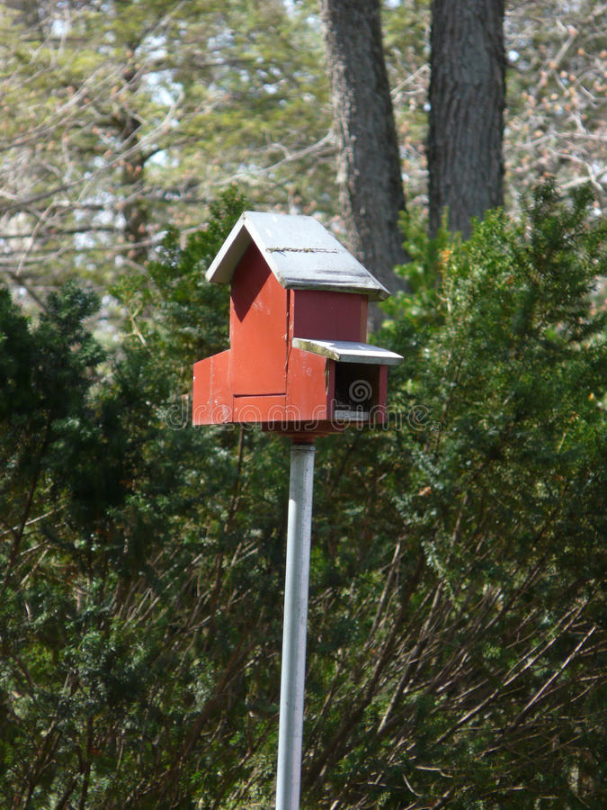 Red Bird Barn. Red wood bird house constructed in the form of a barn royalty free stock photo