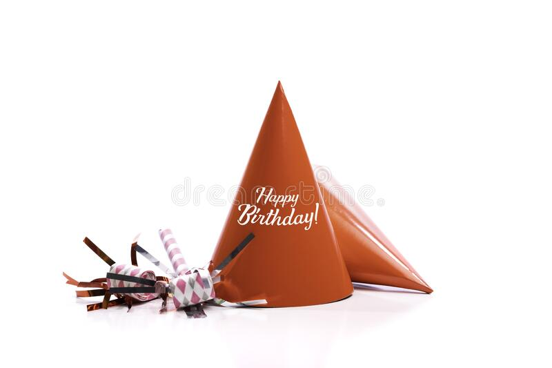 Red birthday hats and noise-makers on a white background. stock photography