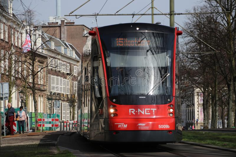 Red and Black Avenio Siemens trams on the Street in The Hague stock photography