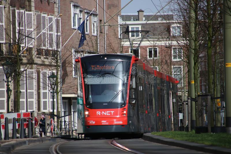 Red and Black Avenio Siemens trams on the Street in The Hague royalty free stock photography