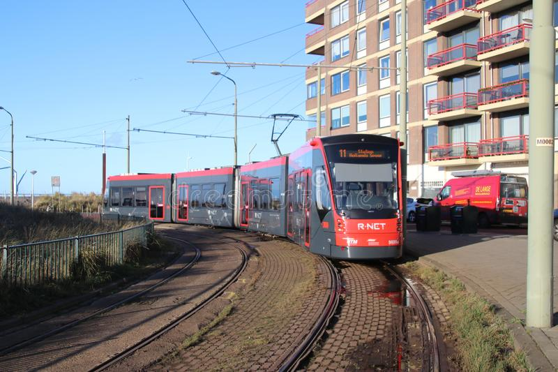 Red and Black Avenio Siemens trams on the Street in scheveningen close to The Hague stock photos