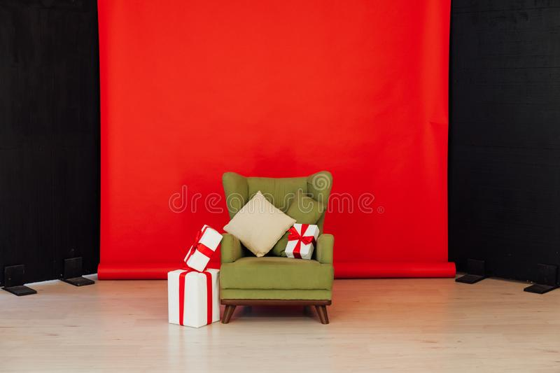 Red black background chair with gifts for Christmas birthday party royalty free stock images