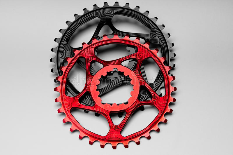 Red and black Bicycle chainring royalty free stock photo