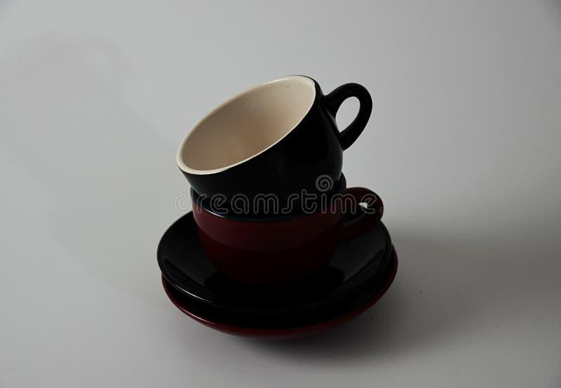 Red and Black Ceramic Mugs stock photo