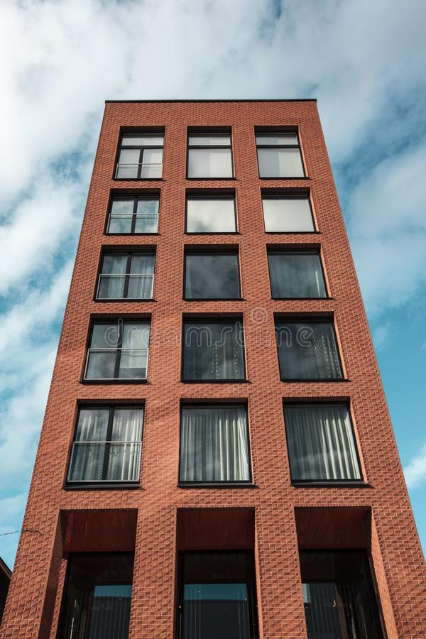 Red and Black Concrete High-rise Building stock image