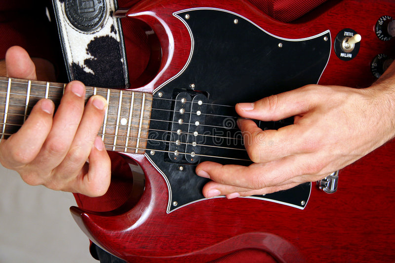 Red and black electric guitar stock photography