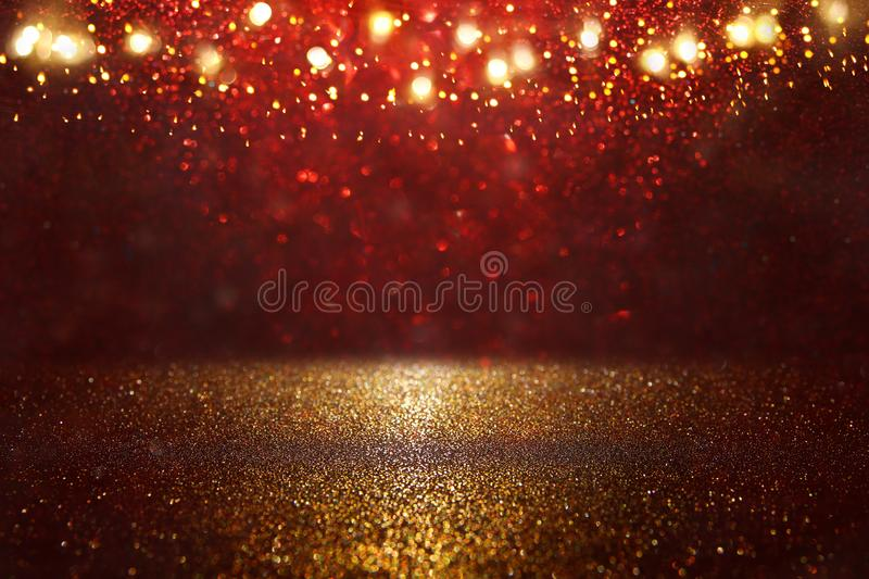 Red, black and gold glitter lights background. defocused. Red, black and gold glitter lights background. defocused royalty free stock photo