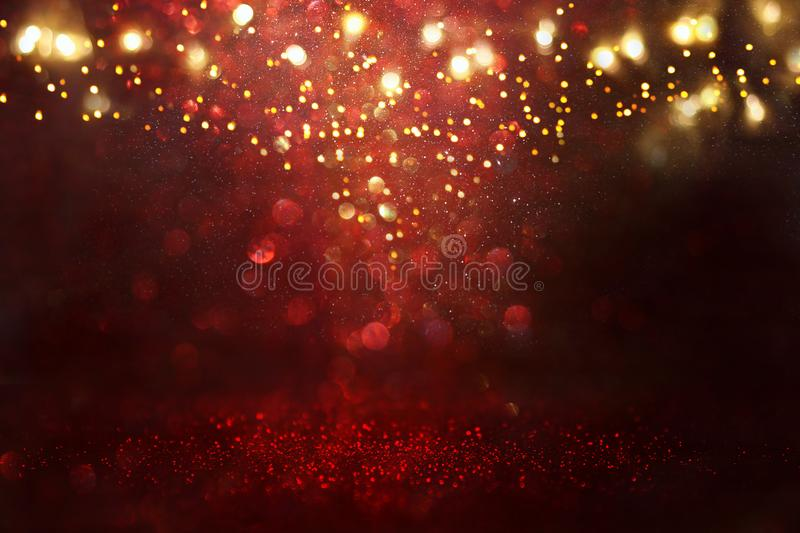 Red, black and gold glitter vintage lights background. defocused. Red, black and gold glitter vintage lights background. defocused royalty free stock photo