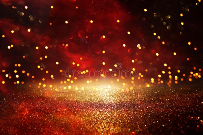 Red, black and gold glitter vintage lights background. defocused. Red, black and gold glitter vintage lights background. defocused royalty free stock photos