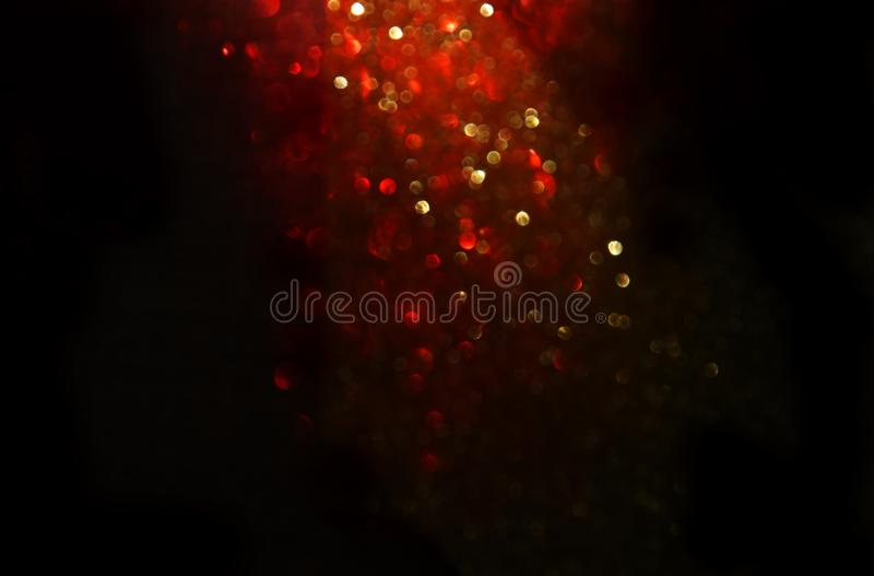 Red, black and gold glitter vintage lights background. defocused. Red, black and gold glitter vintage lights background. defocused royalty free stock photography