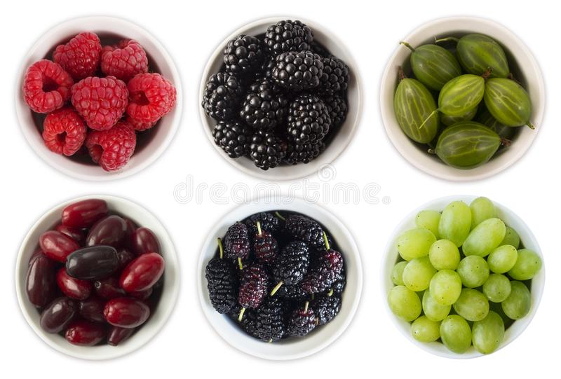 Red, black and green food. Fruits and berries in bowl isolated on white. Sweet and juicy berry with copy space for text. Rasberrie stock image