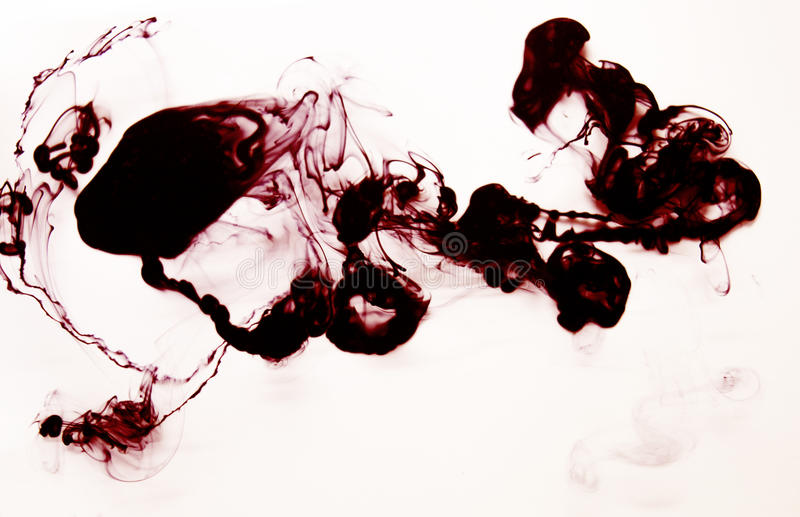 Red and black ink cloud in water hand made DIY texture isolated on white. stock image