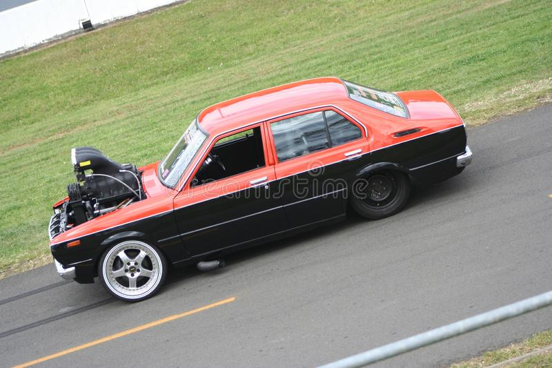 Red and black modified Drag Racing car with large powerful engine stock image