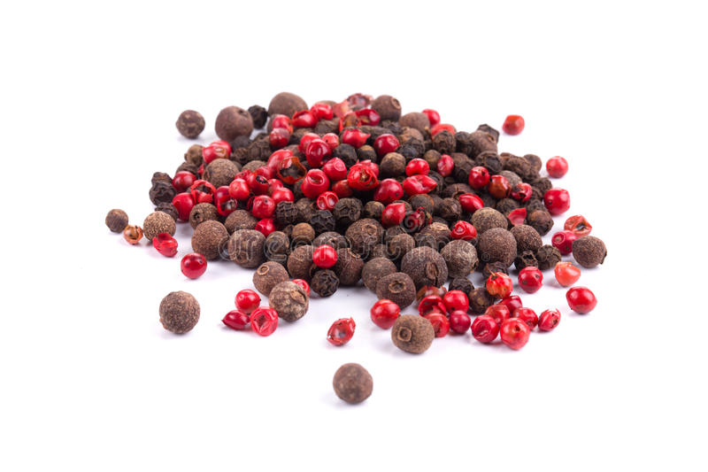 Red and black peppercorn. On a white background royalty free stock photos