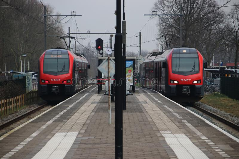 Red black R-NET trains on the railroad track at station of Waddinxveen between Gouda and Alphen stock photo