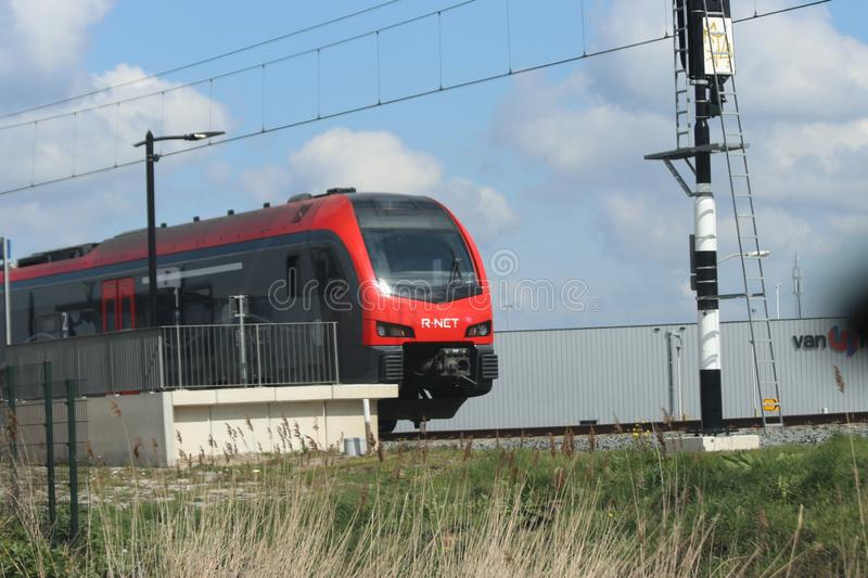 Red and black R-Net trains type Flirt runned by Albellio at station Waddinxveen Triangel. royalty free stock photo