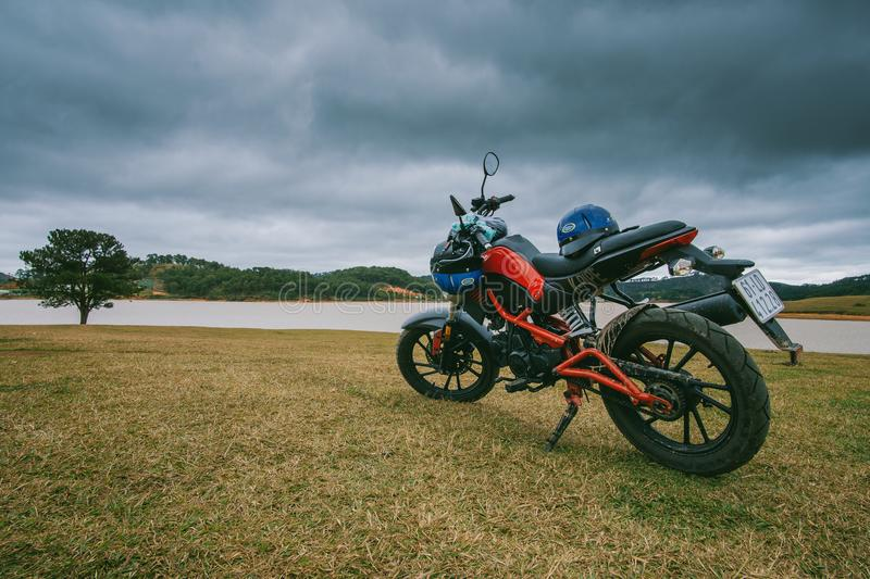 Red and Black Standard Motorcycle on Green Grass Field royalty free stock photos