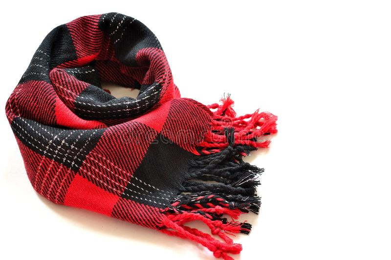 Red and black tartan scarf. Funky red and black tartan scarf on isolated white background stock images