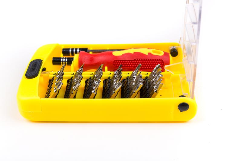 Red black and yellow screwdriver and tool bits. Red black and yellow screwdriver and tool bit set stock photography