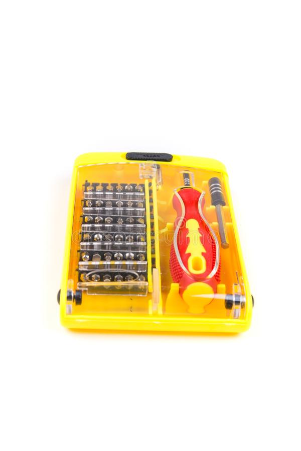 Red black and yellow screwdriver and tool bits. Red black and yellow screwdriver and tool bit set royalty free stock photography