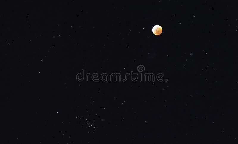 Red blood moon and stars in the sky. During total moon eclipse January 20, 2019 royalty free stock photography