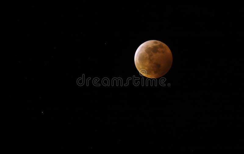 Red blood moon and stars in the sky royalty free stock photo