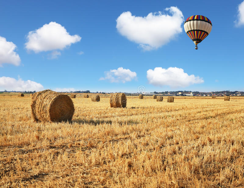 Red And Blue Balloon Slowly Floating Over Field Stock Images