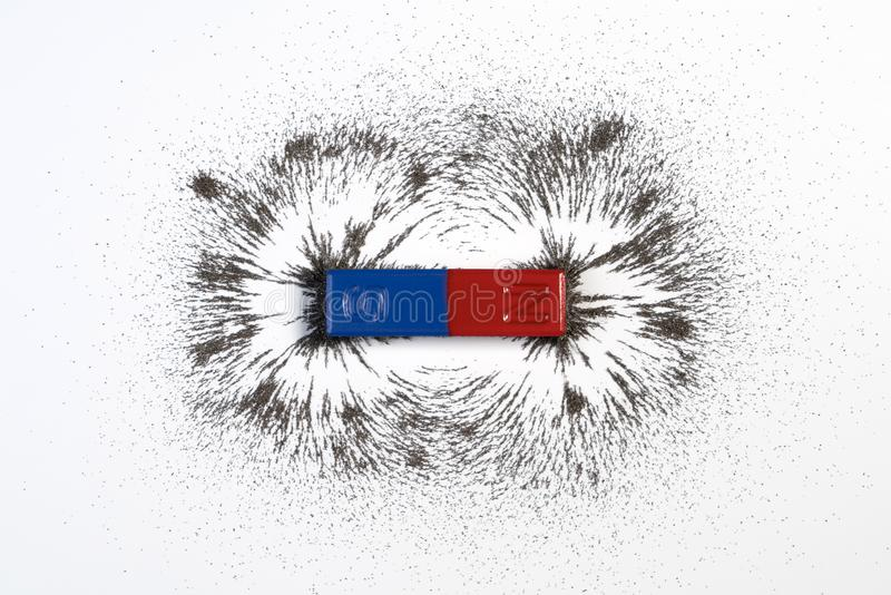 Red and blue bar magnet or physics magnetic with iron powder mag royalty free stock images