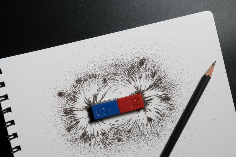 Red and blue bar magnet or physics magnetic, pencil and iron pow royalty free stock images