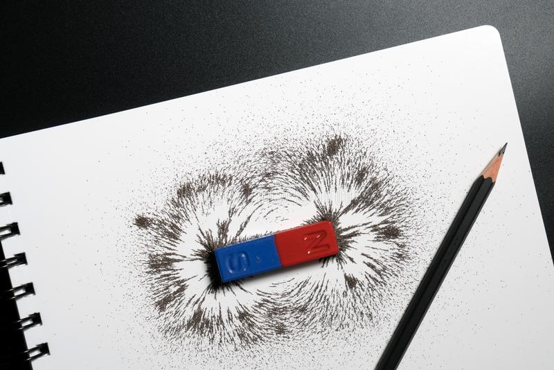 Red and blue bar magnet or physics magnetic, pencil and iron pow stock images