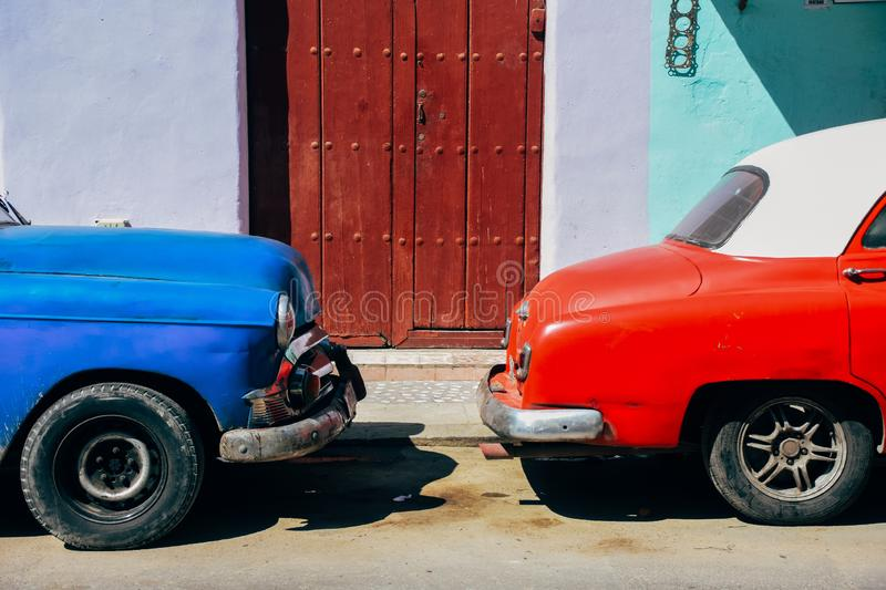 A red and blue classic car parked in Havana, Cuba. A red and blue beautiful classic cars parked in Havana, Cuba stock images