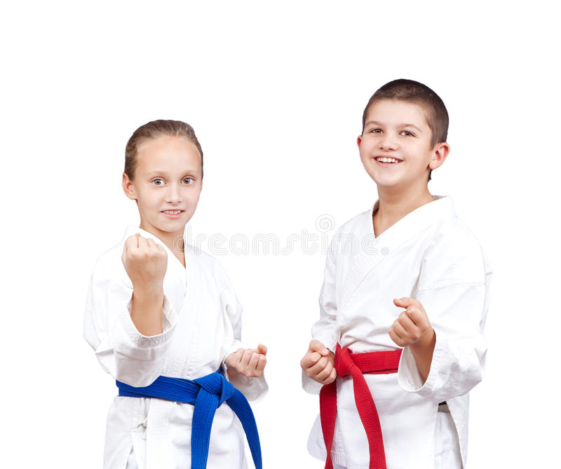 With red and blue belt the children stand in rack of karate royalty free stock photos
