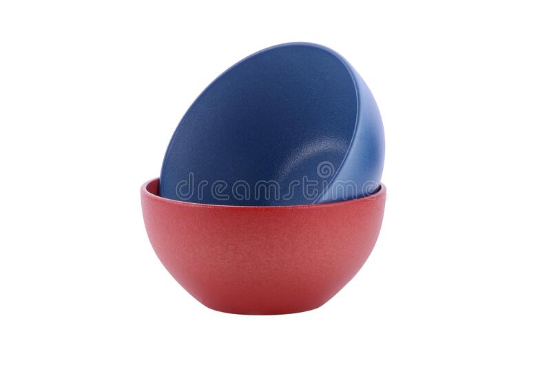 Red and blue bowl on white background stock photography