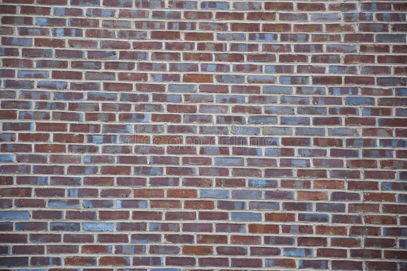 Red and blue brick wall background. Red and blue brick building wall background royalty free stock photography