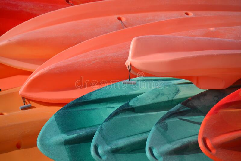 Red and blue canoes stock photo