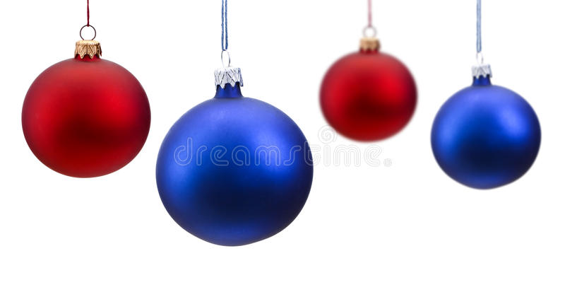 Red and Blue Christmas Balls isolated. Blue and Red Christmas balls, hanging from a wire, isolated on a white background stock images