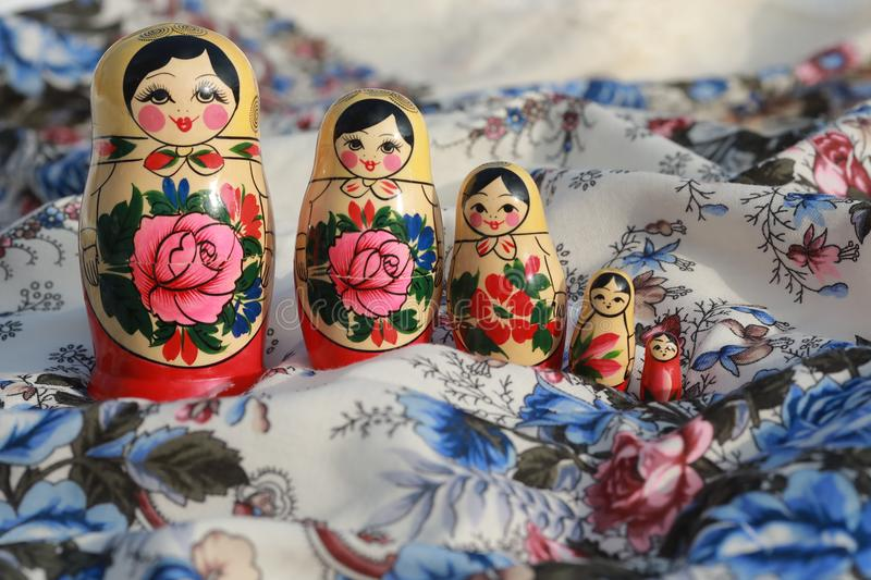 Wooden dolls russian souvenirs matryoshka. Red blue colour wooden dolls painted with flowers russian souvenirs from russia moscow stock image
