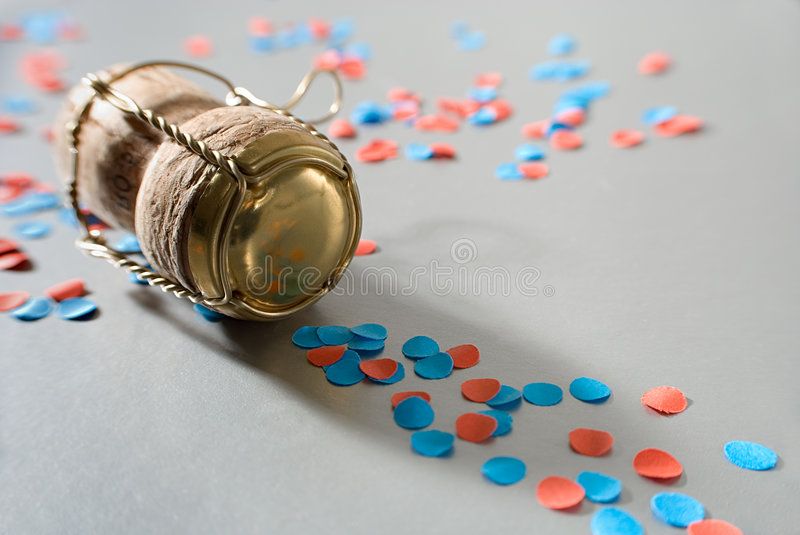 Red and blue confetti with campagne cork stock image