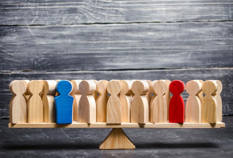 Red and blue figures in a crowd of people on the scales. Confronting of two people and bringing on his side other people. Political processes and games royalty free stock images