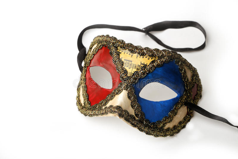 Red, Blue and Gold Ornate Masquerade Mask on White Background royalty free stock photo