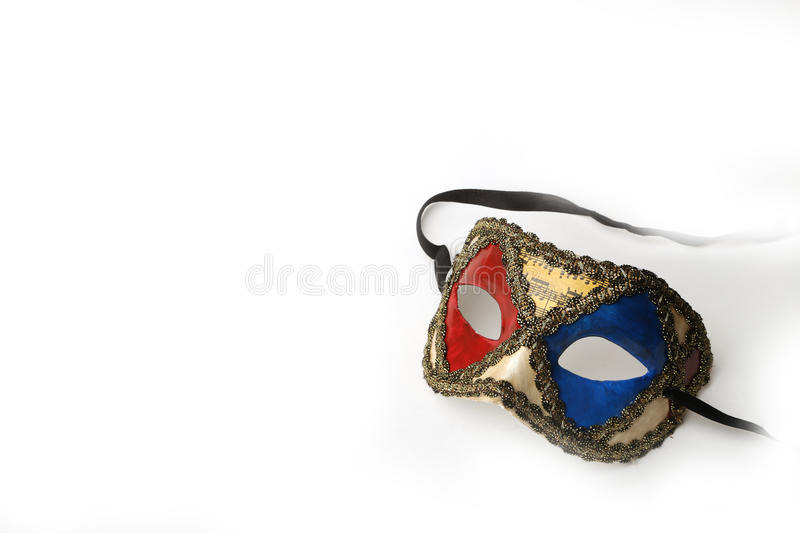Red, Blue and Gold Ornate Masquerade Mask on White Background stock image