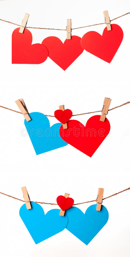 Red and blue hearts. With clothespins on rope royalty free stock photos