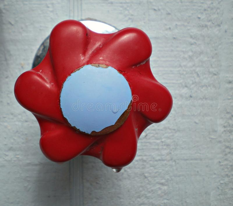 Red and blue knob in outdoor shower. Up close red and blue knob in outdoor shower stock photography