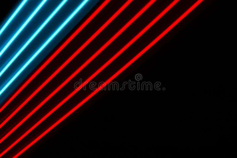 Multicolor light  lines on a black background. Red and blue light dynamic lines on a black background stock images
