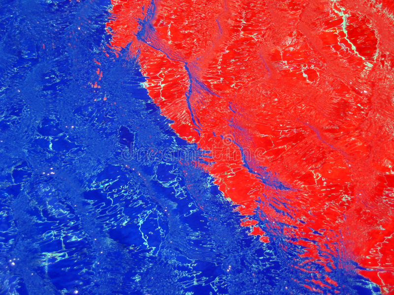 Red and blue patterns in a pool royalty free stock images